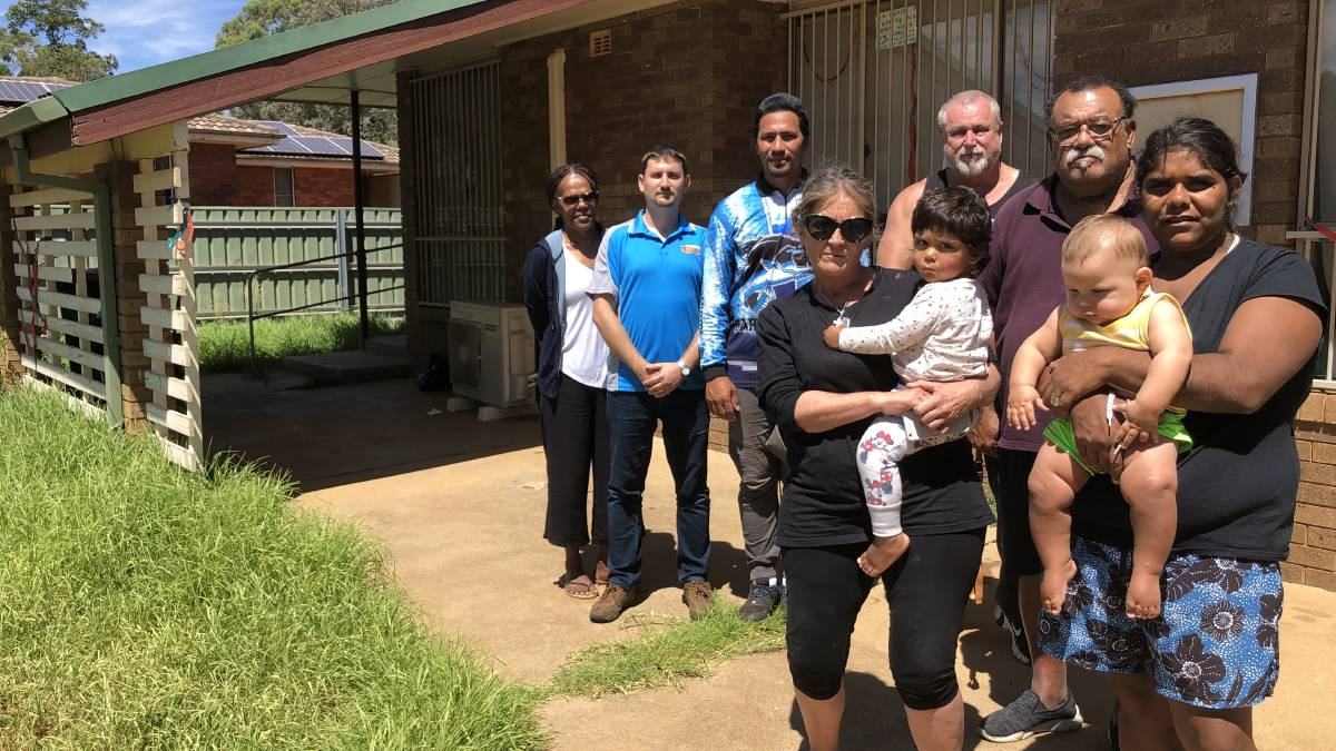 BROKEN PROMISES: Concerned members of the Pioneer community and representatives of the Seventh Day Adventist Church standing in front of the run-down Alma Bamblett Centre. PHOTO: Kat Vella