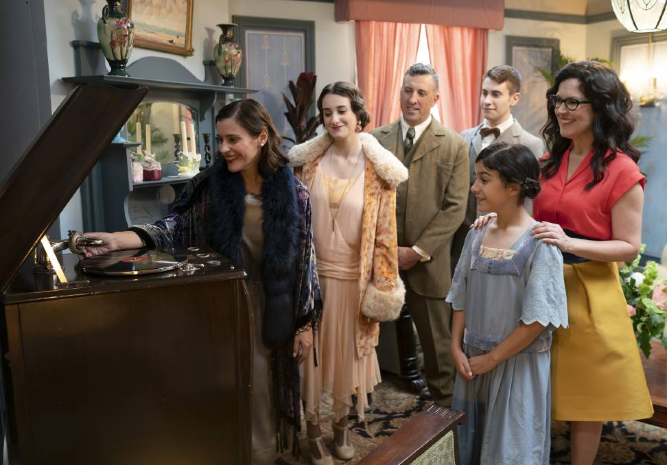 OLD FASHIONED: The Ferrone family, from left, Carol, Sienna, Peter, Julian, Olivia with Further Back In Time For Dinner host Annabel Crabb.