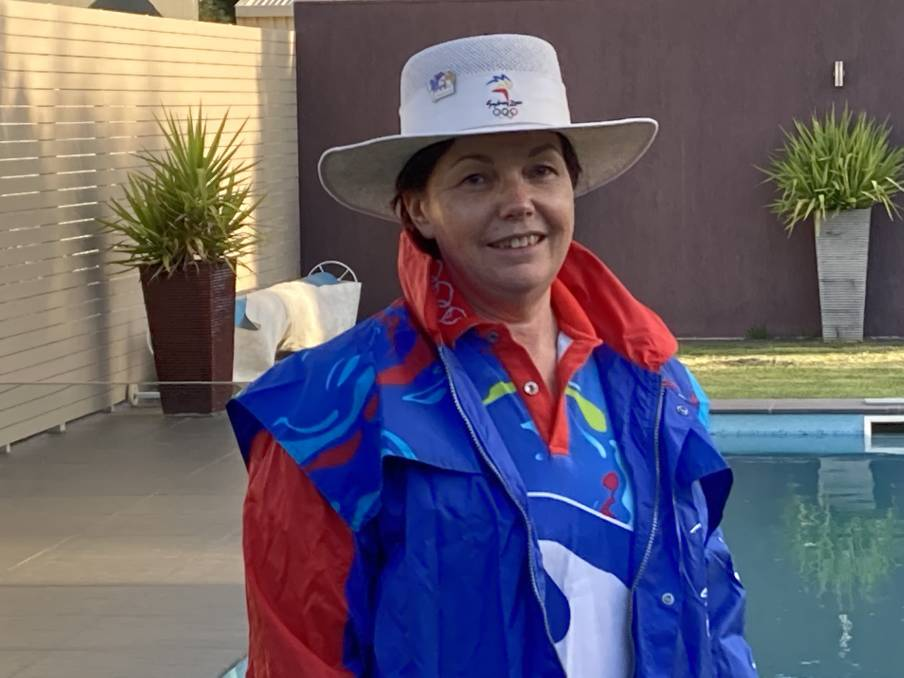 BACK AT IT: Leeton physio Sally Hill returns to her uniform to commemorate 20 years since she worked in the athletes village at the Sydney 2000 Olympics. Picture: supplied