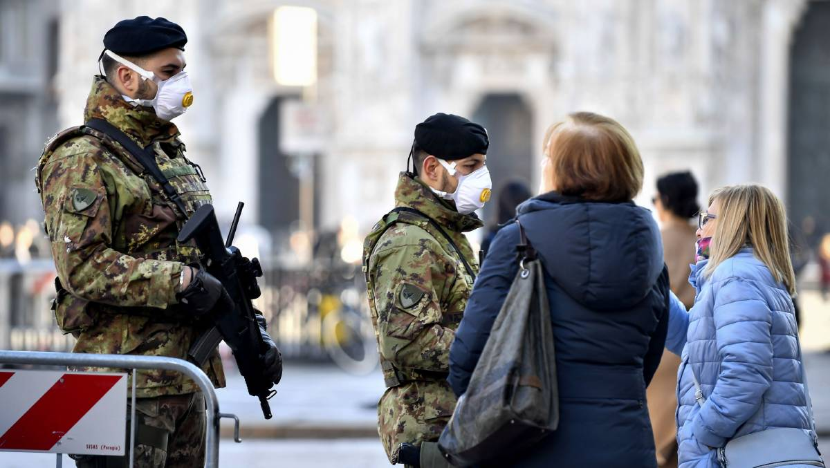 Military officers wearing face masks stand outside Duomo cathedral in Milan, closed by authorities due to a coronavirus outbreak. Picture: Shutterstock