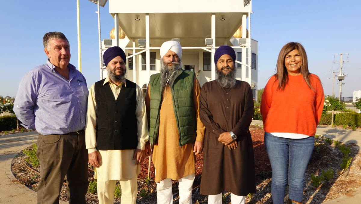 COMMUNITY: The CEF's Craig O'Keefe (left) and Sherene Blumer (right) alongside Gursahib Singh, Kulwant Singh, and Hardeep Singh. PHOTO: Monty Jacka