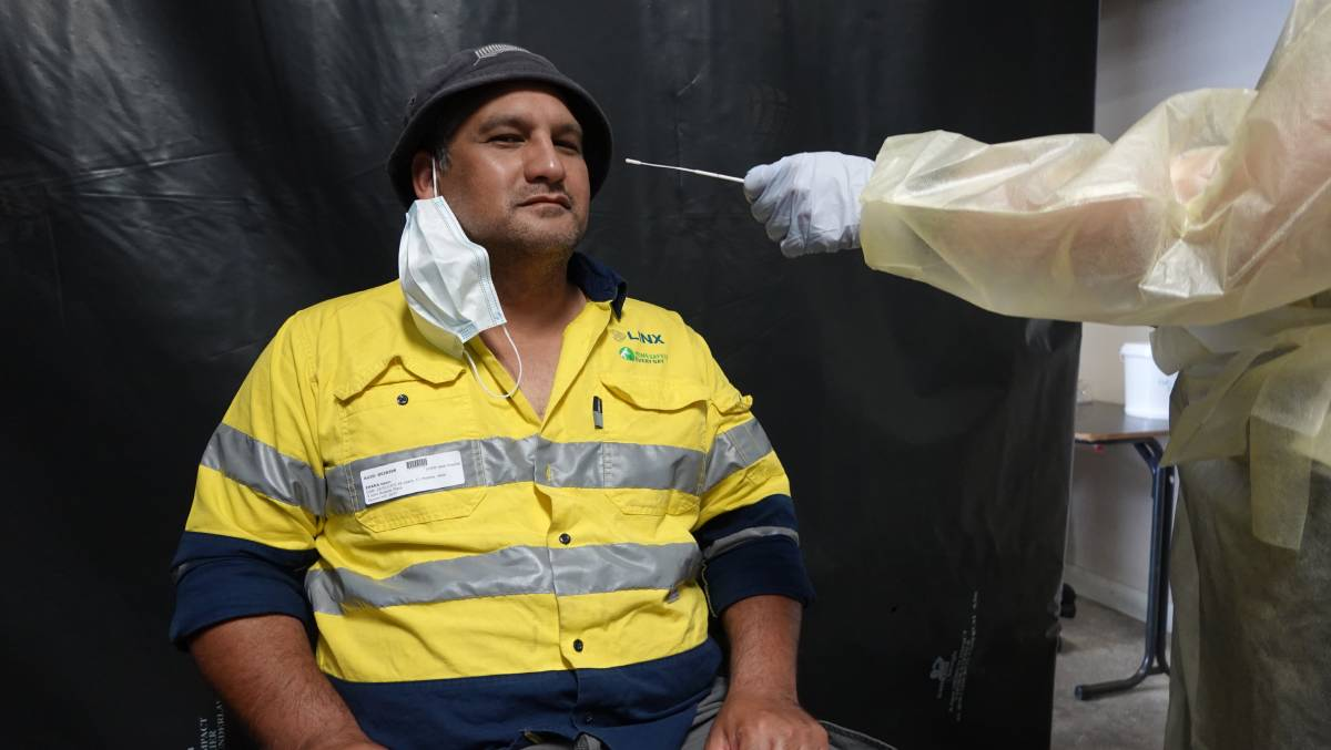 BETTER SAFE THAN SORRY: Interstate truck driver Eddie Ihaka getting his COVID-19 swab test at the Griffith testing centre on Yambil Street. PHOTO: Monty Jacka